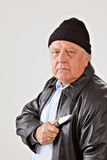 Hombre maduro con el cuchillo Fotos de archivo