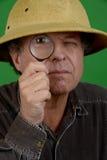 Hombre maduro con la lupa Imagen de archivo libre de regalías