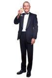 Hombre maduro en champán de consumición del smoking. Fotos de archivo