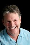 Hombre maduro en el negro - risa Imagen de archivo libre de regalías