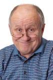 Hombre mayor calvo que engaña alrededor Foto de archivo libre de regalías