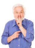Hombre mayor con el finger en los labios Fotografía de archivo