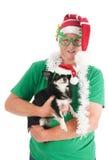 Hombre mayor con el pequeño perro para la Navidad Foto de archivo libre de regalías