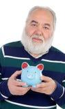 Hombre mayor con la barba blanca y un moneybox azul fotografía de archivo libre de regalías