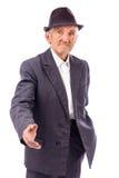 Hombre mayor con la mano extendida para un apretón de manos Foto de archivo libre de regalías