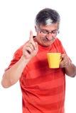 Hombre mayor con la taza Imagen de archivo libre de regalías