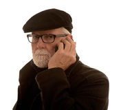 Hombre mayor con un teléfono móvil Fotos de archivo