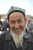Hombre mayor de la pertenencia étnica de Uyghur Fotos de archivo libres de regalías