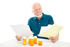Hombre mayor deprimido - cuentas médicas Imágenes de archivo libres de regalías