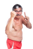 Hombre mayor descamisado enojado Foto de archivo