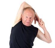 Hombre mayor. El estirar Foto de archivo libre de regalías