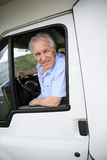 Hombre mayor en coche que acampa Imágenes de archivo libres de regalías