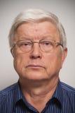Hombre mayor en vidrios Imágenes de archivo libres de regalías