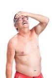 Hombre mayor infeliz con dolor de cabeza Fotografía de archivo libre de regalías