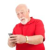 Hombre mayor - mensaje de texto asombrosamente imagenes de archivo