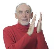 Hombre mayor que aplaude Foto de archivo