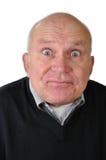Hombre mayor que hace caras Foto de archivo libre de regalías