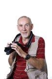 Hombre mayor sonriente con la cámara Imagen de archivo libre de regalías