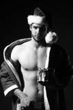 Hombre muscular del Año Nuevo Fotografía de archivo libre de regalías