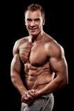 Hombre muscular joven hermoso de los deportes Foto de archivo libre de regalías