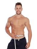 Hombre musculoso con cinta métrica Fotografía de archivo libre de regalías