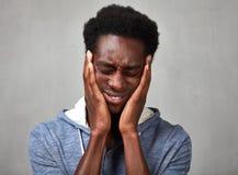 Hombre negro de la depresión Imagenes de archivo