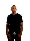 Hombre negro joven en camiseta y pantalones vaqueros Imágenes de archivo libres de regalías
