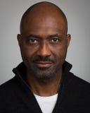 Hombre negro sin afeitar calvo en sus años 40 Imagen de archivo libre de regalías