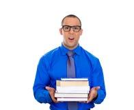 Hombre Nerdy, libros que se sostienen ansiosos Imágenes de archivo libres de regalías