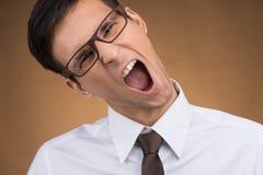 Hombre o estudiante joven de negocios que grita Foto de archivo libre de regalías