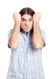 Hombre obstinado enojado imagenes de archivo