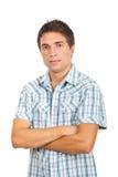 Hombre ocasional con los brazos plegables Imagen de archivo