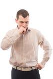 Hombre pensativo de 30 años en una camisa con las rayas Foto de archivo libre de regalías