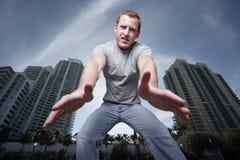 Hombre que alcanza al gancho agarrador Foto de archivo libre de regalías