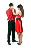 Hombre que besa la mano de la mujer Foto de archivo
