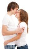 Hombre que besa a la mujer Fotos de archivo