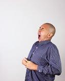 Hombre que bosteza Imagenes de archivo