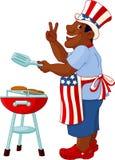 Hombre que cocina una hamburguesa Imagen de archivo