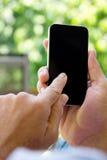 Hombre que comprueba su fondo del teléfono Imagen de archivo libre de regalías