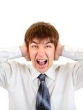 Hombre que cubre sus oídos Fotografía de archivo libre de regalías