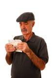 Hombre que cuenta libras británicas imagen de archivo libre de regalías