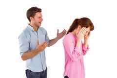 Hombre que da a mujer un dolor de cabeza Imágenes de archivo libres de regalías
