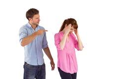 Hombre que da a mujer un dolor de cabeza Foto de archivo