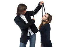 Hombre que detiene a la mujer con el azote Foto de archivo libre de regalías