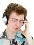 Hombre que disfruta de música Fotografía de archivo