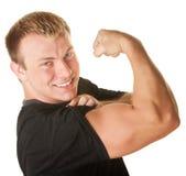 Hombre que dobla el bíceps Fotografía de archivo libre de regalías