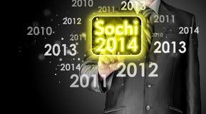 Hombre que empuja el interfaz Sochi 2014 de la pantalla táctil Foto de archivo libre de regalías