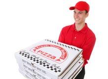 Hombre que entrega las pizzas foto de archivo
