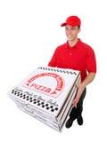 Hombre que entrega las pizzas fotos de archivo