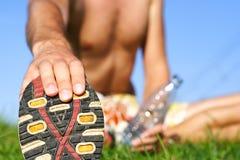 Hombre que estira hacia fuera Imagen de archivo libre de regalías